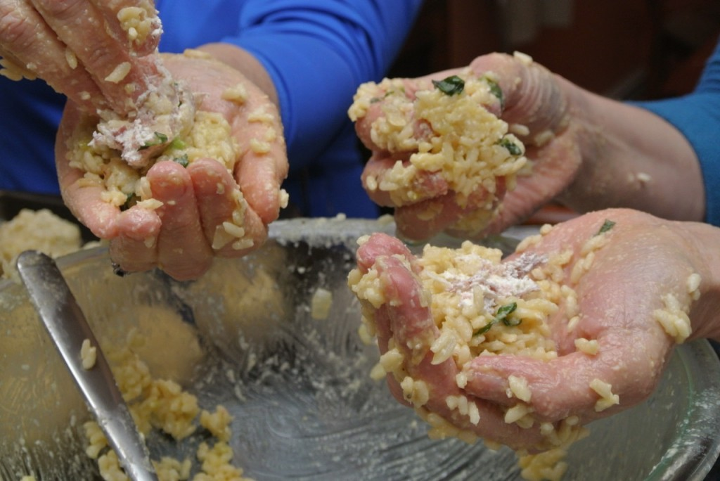 Getting your hands dirty - forming arancini. Italiaoutdoorsfoodandwine bike tours italy