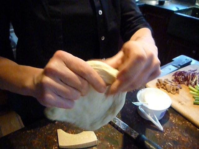Shaping the dough - stretching, not rolling - wine and bike tours italy